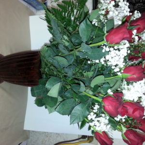 Dozen Red Roses With Baby's Breath In Red Vase