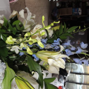 White Lilies, Mums, Blue Bonnets & Assorted Flowers