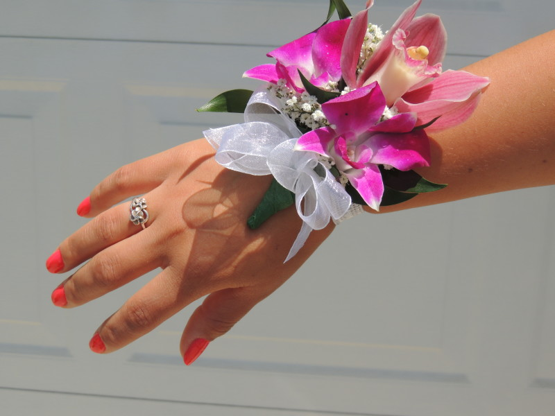 Orchid Corsage With White Ribbon